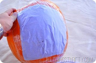 tape-your-pumpkin-pattern-onto-your-pumpkin (3)