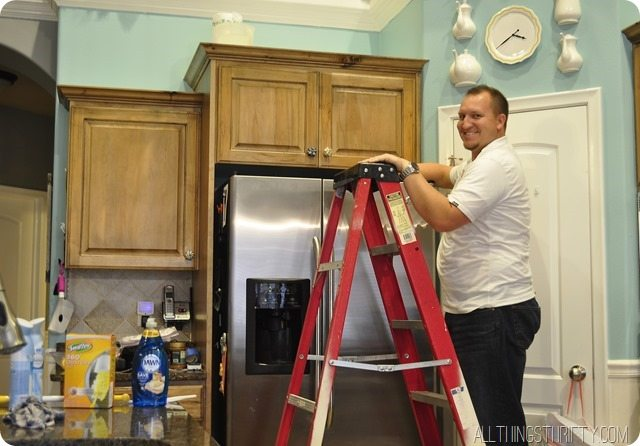 cleaning the top of kitchen cabinets