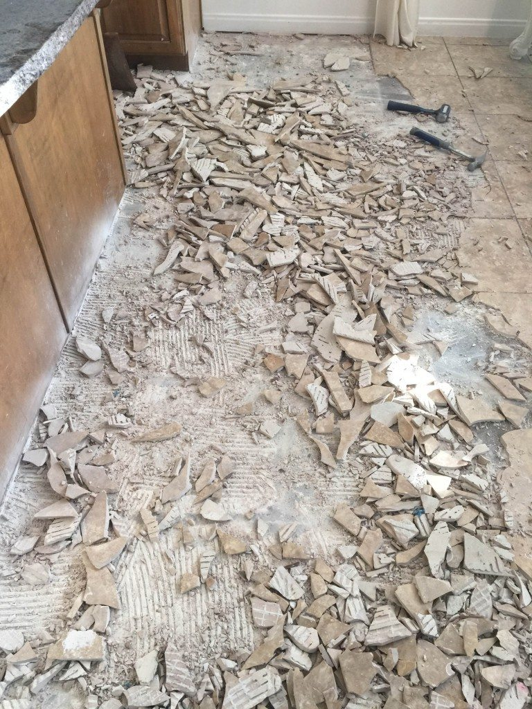 How to remove tile flooring yourself with tips and tricks all tile demolition diy dailygadgetfo Image collections