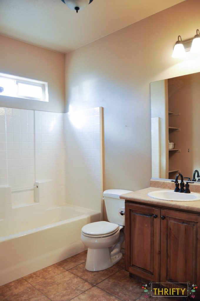 Marvelous Bathroom Makeover from Yucky Tan to Bright and Airy All Things Thrifty