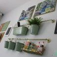 LOVE THIS! Use Ikea's inexpensive kitchen wall storage for high style craft storage! See all the details from Designer Trapped in a Lawyer's Body for All Things Thrifty!