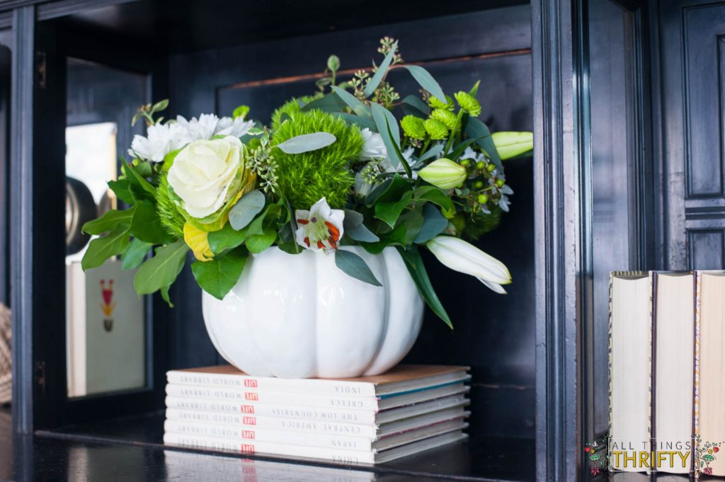 fall decor with pumpkin pot with flowers