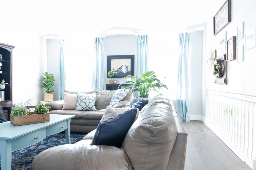Pink navy blue and jade family room decor reveal jo s house for Aqua blue living room ideas