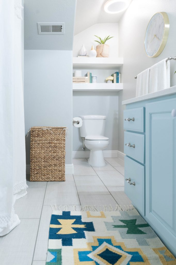 Kids bathroom remodel with pops of light turquoise for Turquoise and grey bathroom accessories