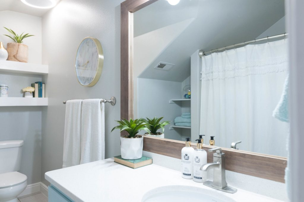 Cool Kids u Bathroom remodel with pops of light turquoise yellow and green All Things Thrifty