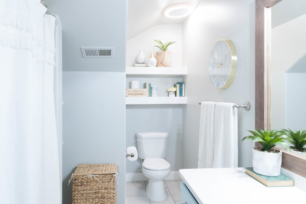 Kids 39 bathroom remodel with pops of light turquoise for Turquoise and grey bathroom accessories